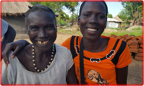 Atto (R) with her mother Pitta (L) at their home in Pagirinya refugee settlement in Adjumani, Northern Uganda.