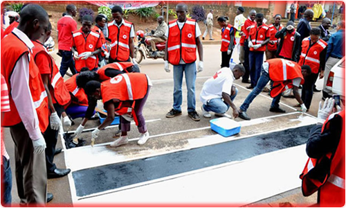 Youths painting a Zebra Crossing in Eastern Uganda